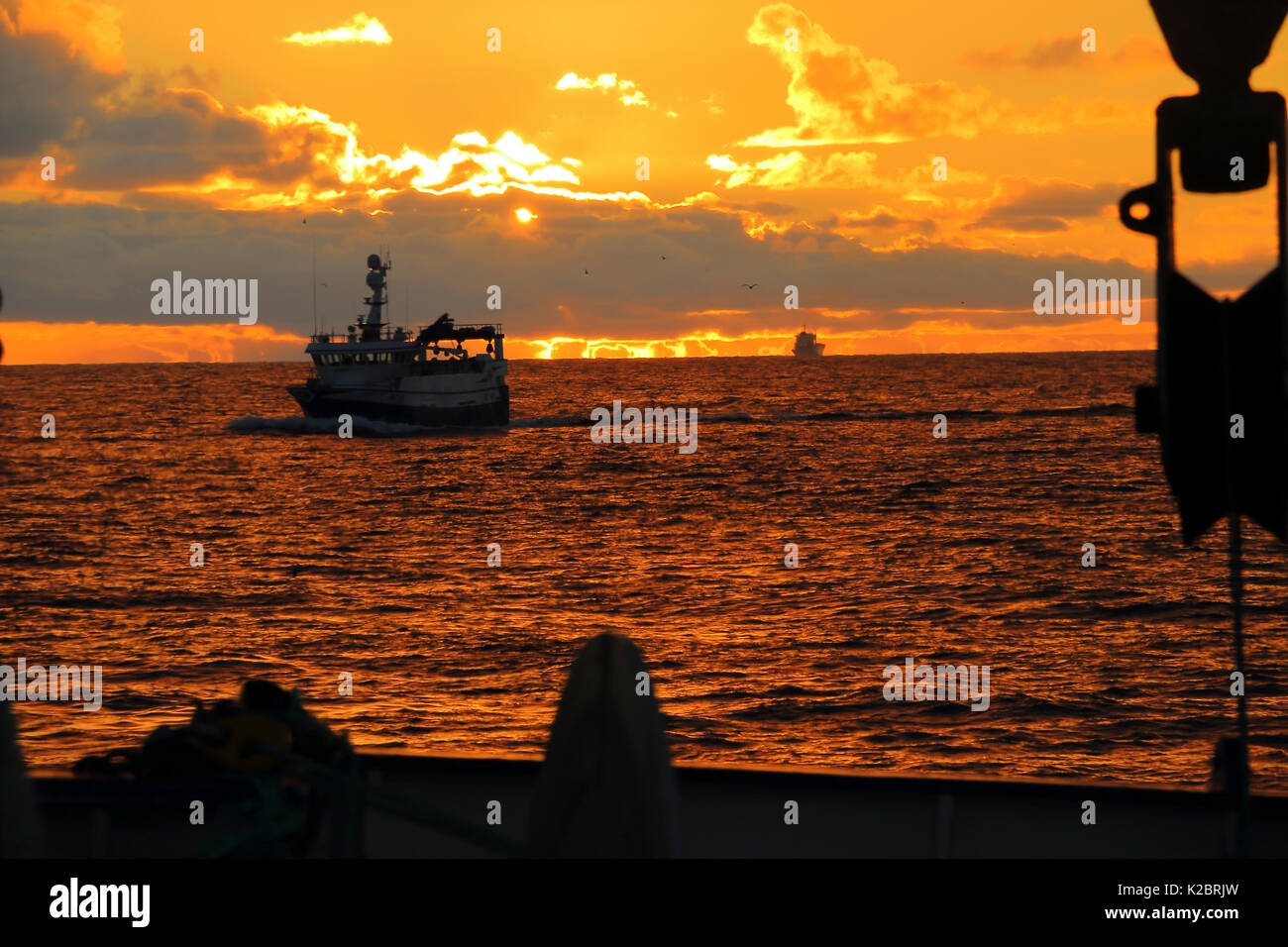 View from a fishing vessel of the golden reflection as the sun rises on the North Sea, October 2014.  All non-editorial uses must be cleared individually. - Stock Image