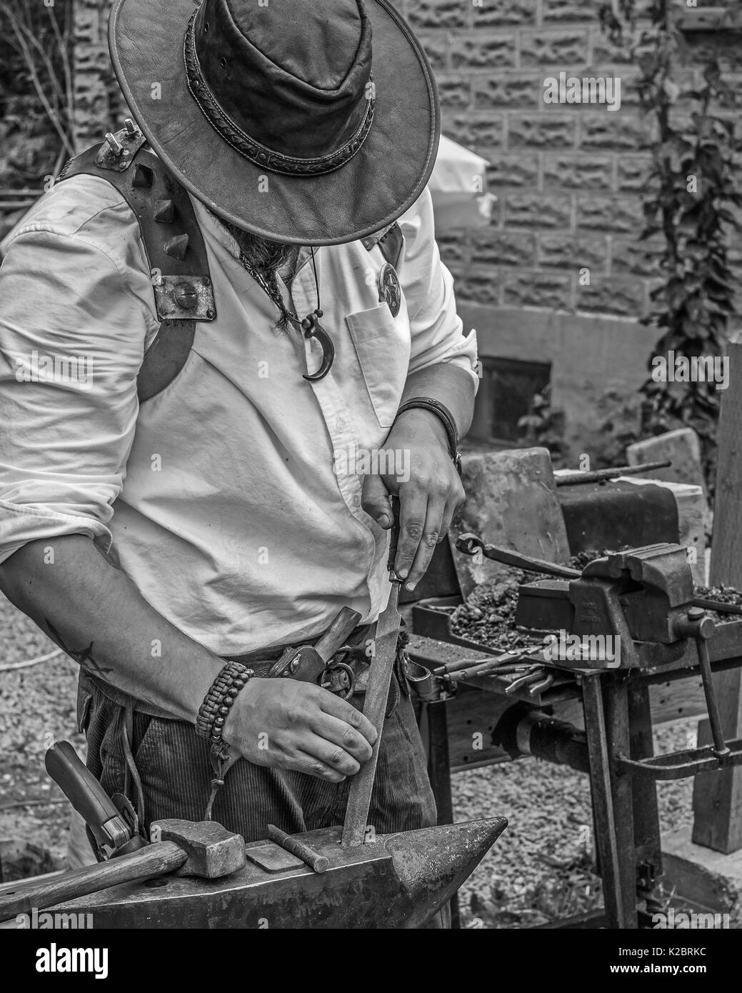 Artisan plies his trade making jewellry at the Coldwater Ontario Steampunk Festival. - Stock Image