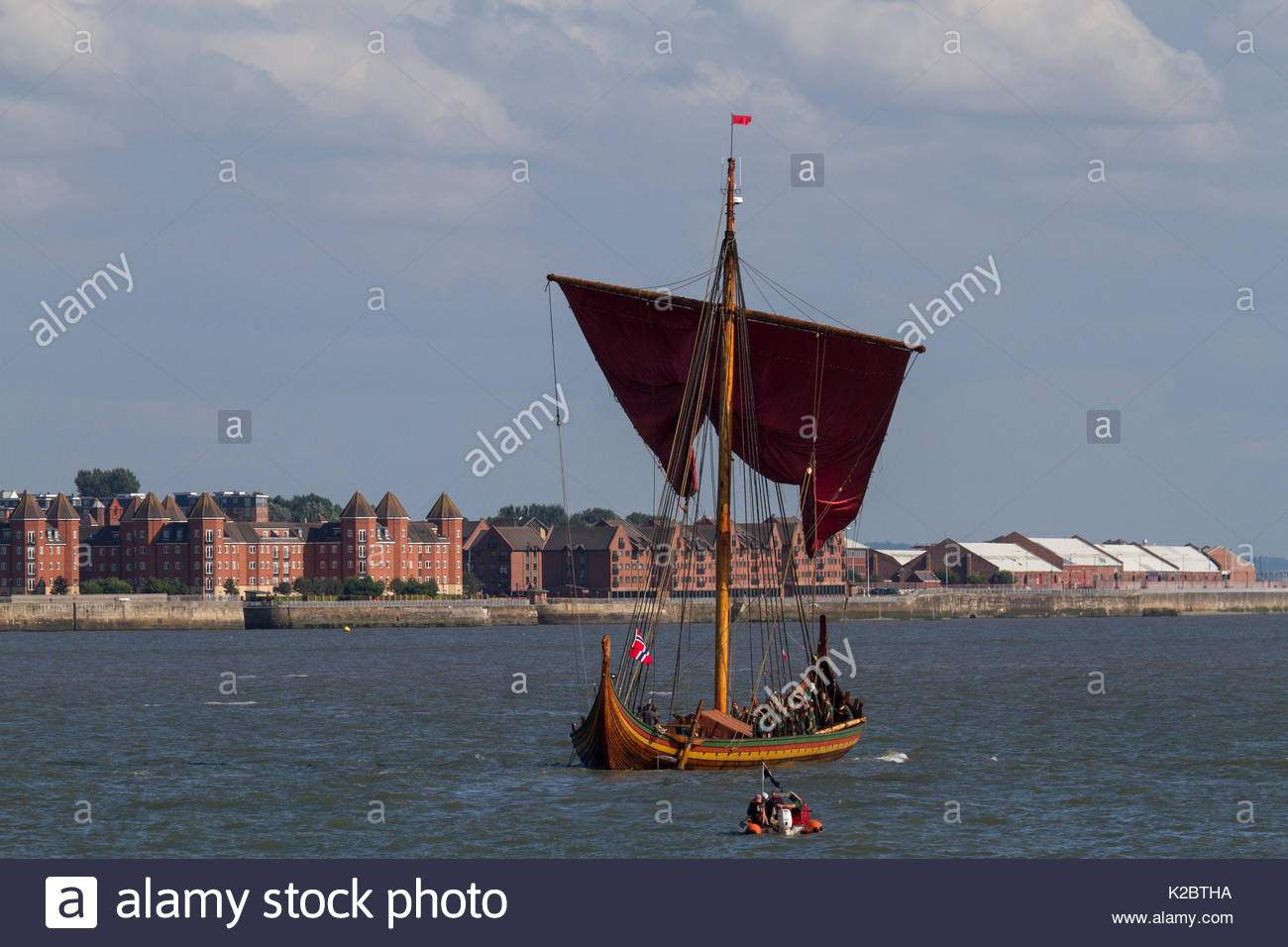 Draken Harald Harfagre (Dragon Harald Fairhair) on the River Mersey. Partially under sail as she departs Birkenhead for her journey back to Norway via the Isle of Man, River Mersey, Merseyside, United Kingdom, 4th August 2014. All non-editorial uses must be cleared individually. - Stock Image