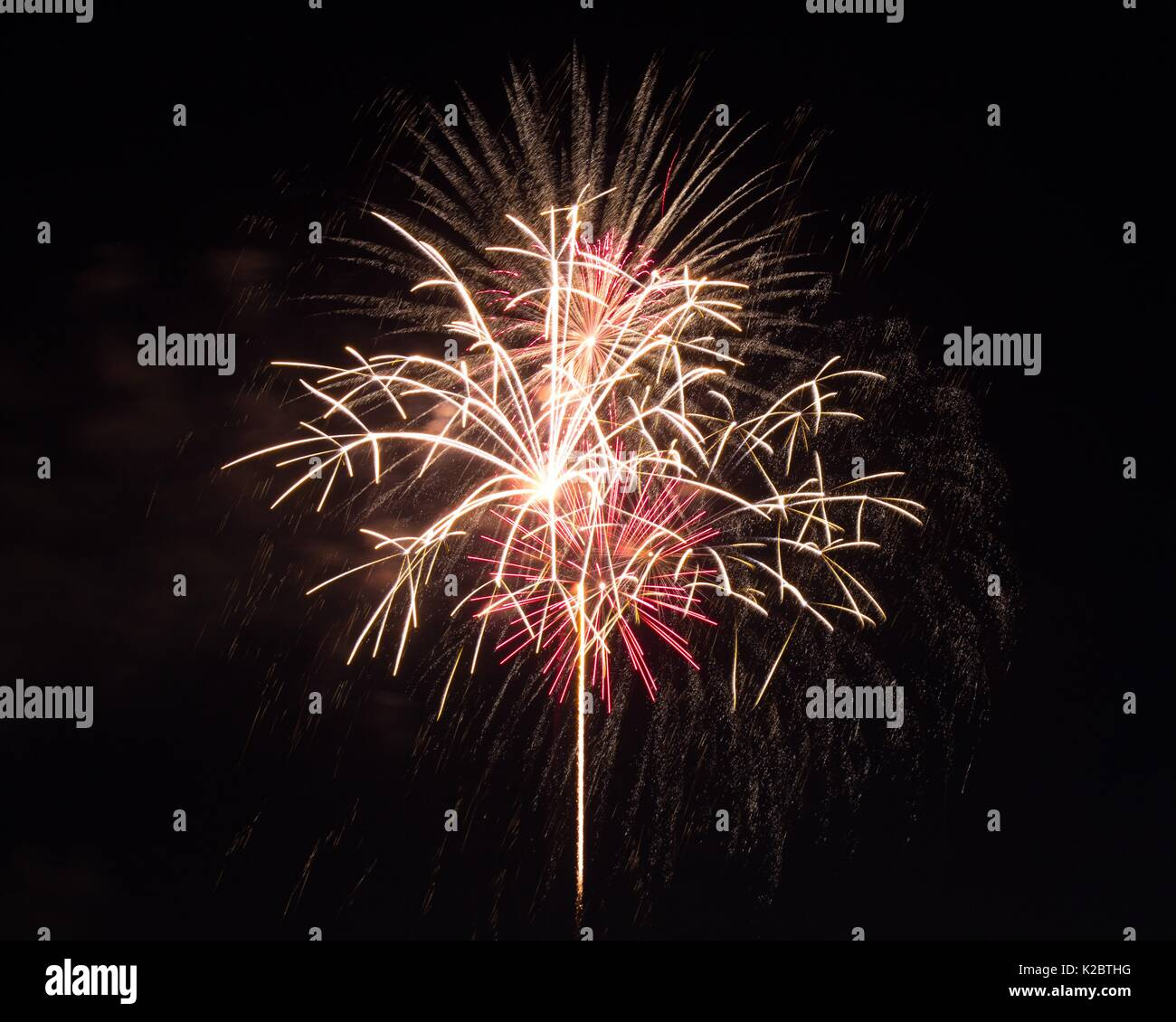 Fireworks burst in the air on 4th of July. Stock Photo