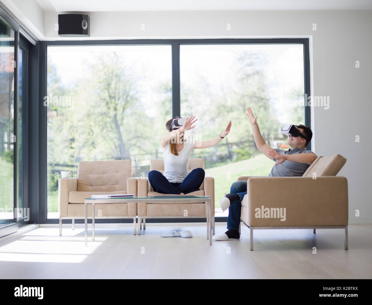 Couple using virtual reality headset in living room at home people ...