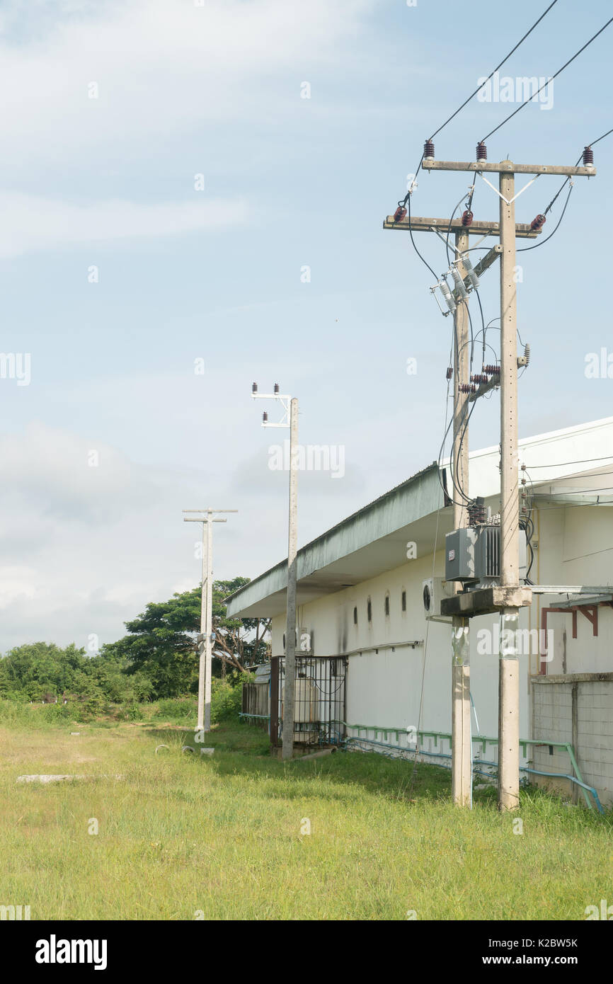 Electrician repair of electric poles. The electric poles supporting wires low voltage and high voltage. - Stock Image