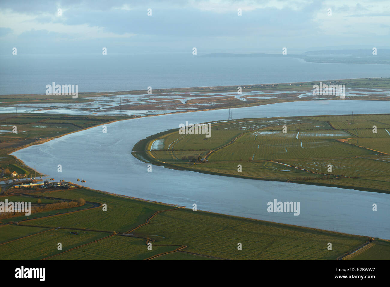 Aerial view of the River Parrett and Steart Marshes Wildfowl and Wetland Trust, Somerset, UK, February 2015.   This area has been allowed to flood by the WWT and the Environment Agency to create new salt marsh habitat and is an example of managed retreat. - Stock Image