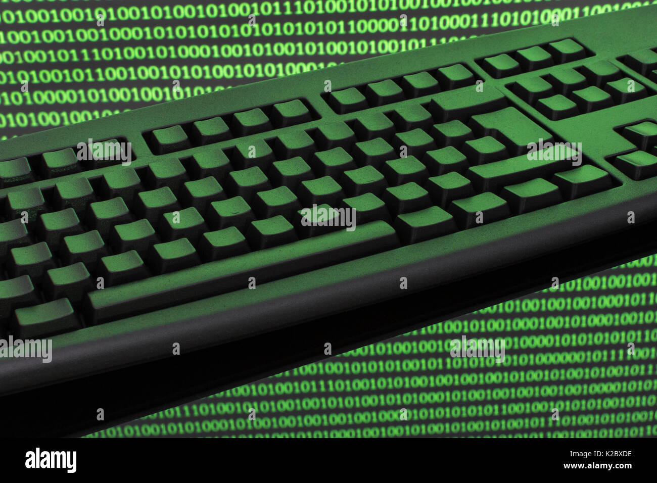 Black keyboard + binary code - for online transactions