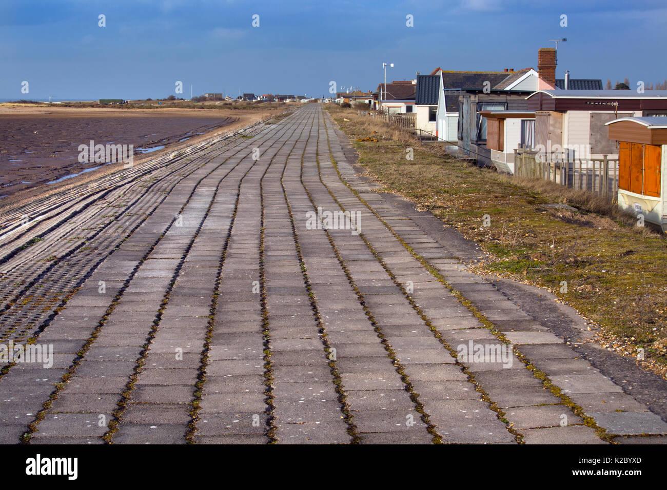 Sea wall and housing vulnerable to flooding around The Wash,  Snettisham, Norfolk, England, UK, February 2015. - Stock Image