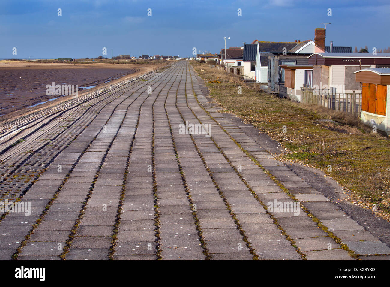 Sea wall and housing vulnerable to flooding around The Wash,  Snettisham, Norfolk, England, UK, February 2015. - Stock Image