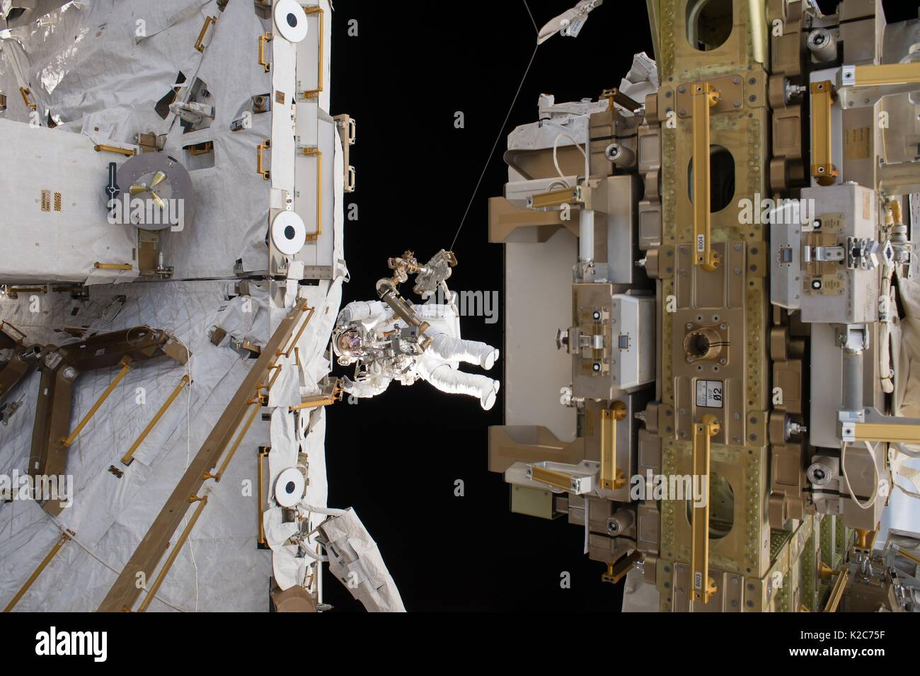 NASA International Space Station Expedition 50 prime crew member French astronaut Thomas Pesquet of the European Space Agency works on the outside of the ISS during an EVA spacewalk March 24, 2017 in Earth orbit. - Stock Image