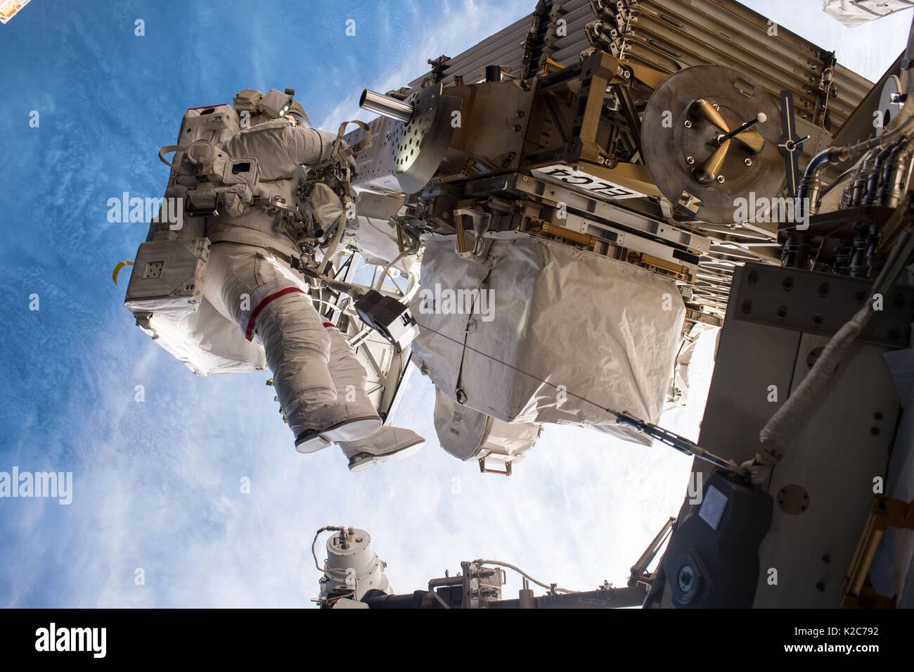 NASA International Space Station Expedition 51 prime crew member American astronaut Peggy Whitson works on the outside of the ISS during an EVA spacewalk May 12, 2017 in Earth orbit. - Stock Image