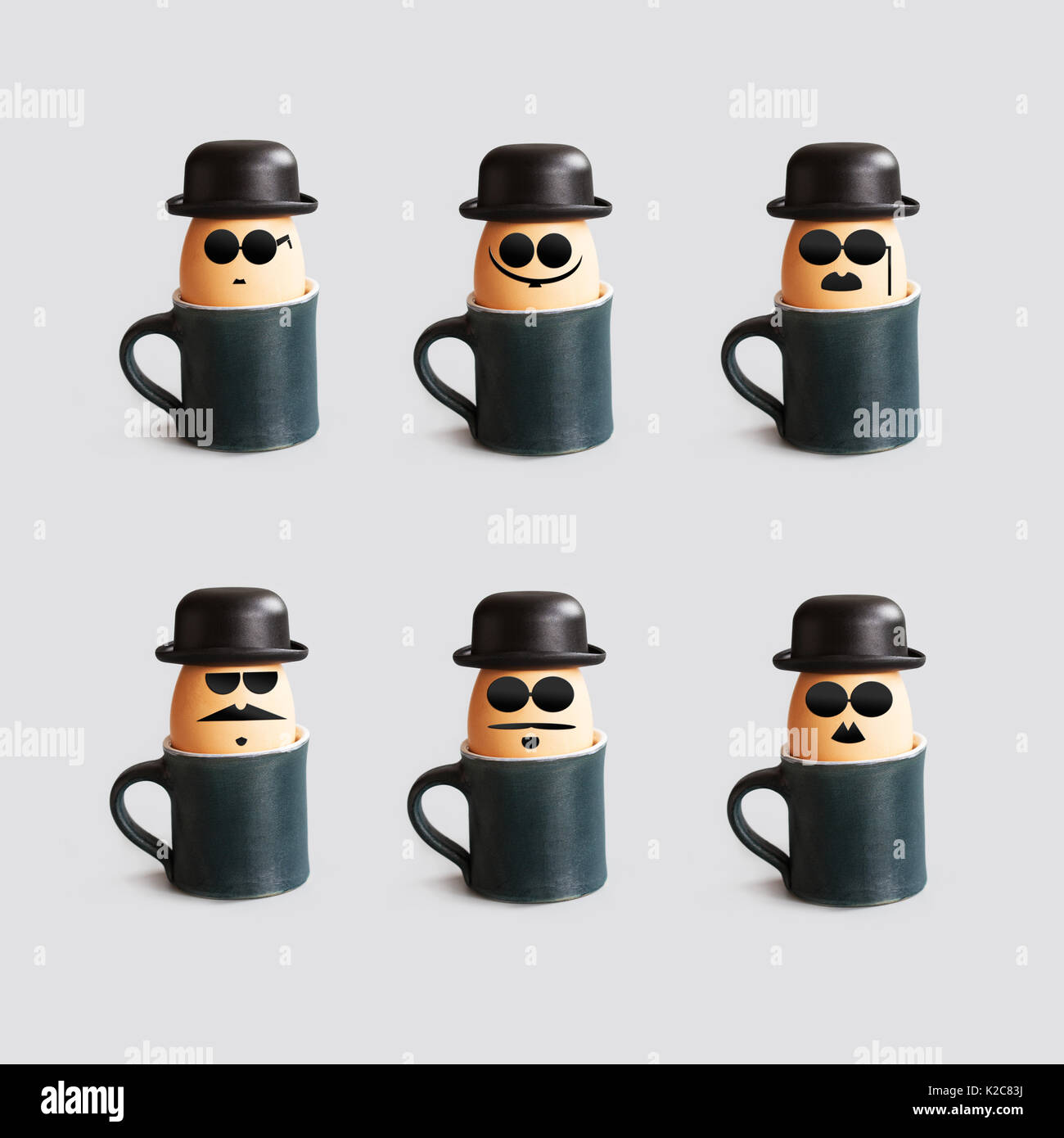 Hipster breakfast egg characters with mustache, beard, black bowler hat and glasses. Creative design holiday poster eggs cups. drawn gentleman faces vintage style. gray background. - Stock Image