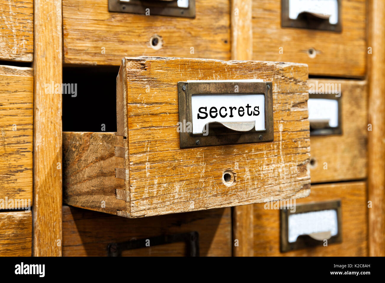 Secrets information concept. Opened box archive storage, filing cabinet interior. wooden boxes with index cards. library service management - Stock Image