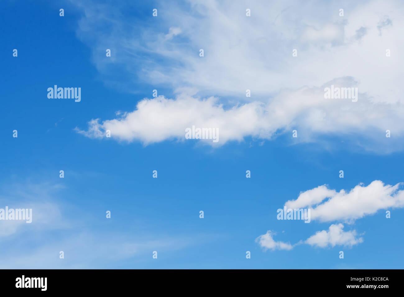 Blue sky background with white clouds. Summertime landscape - Stock Image
