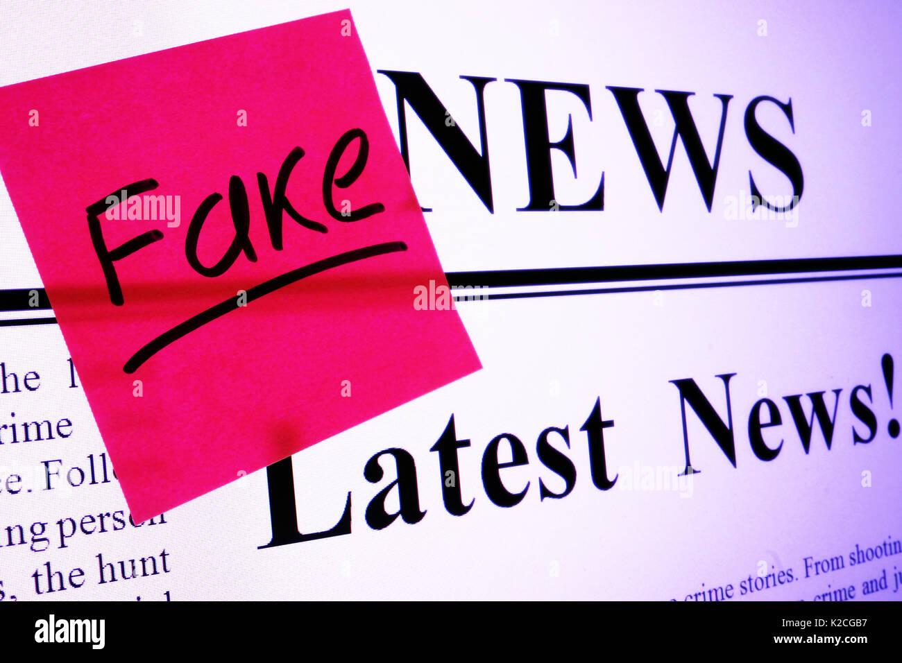 Propaganda concept. Screen of monitor with Fake news. - Stock Image