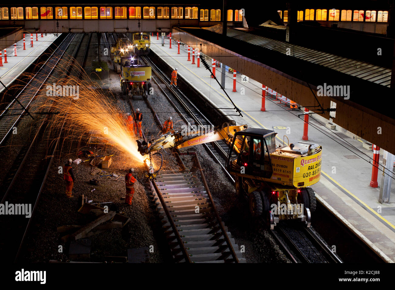 Network rail Railway engineering work, track renewal underway at Lancaster on the west coast main line early on a Sunday morning - Stock Image