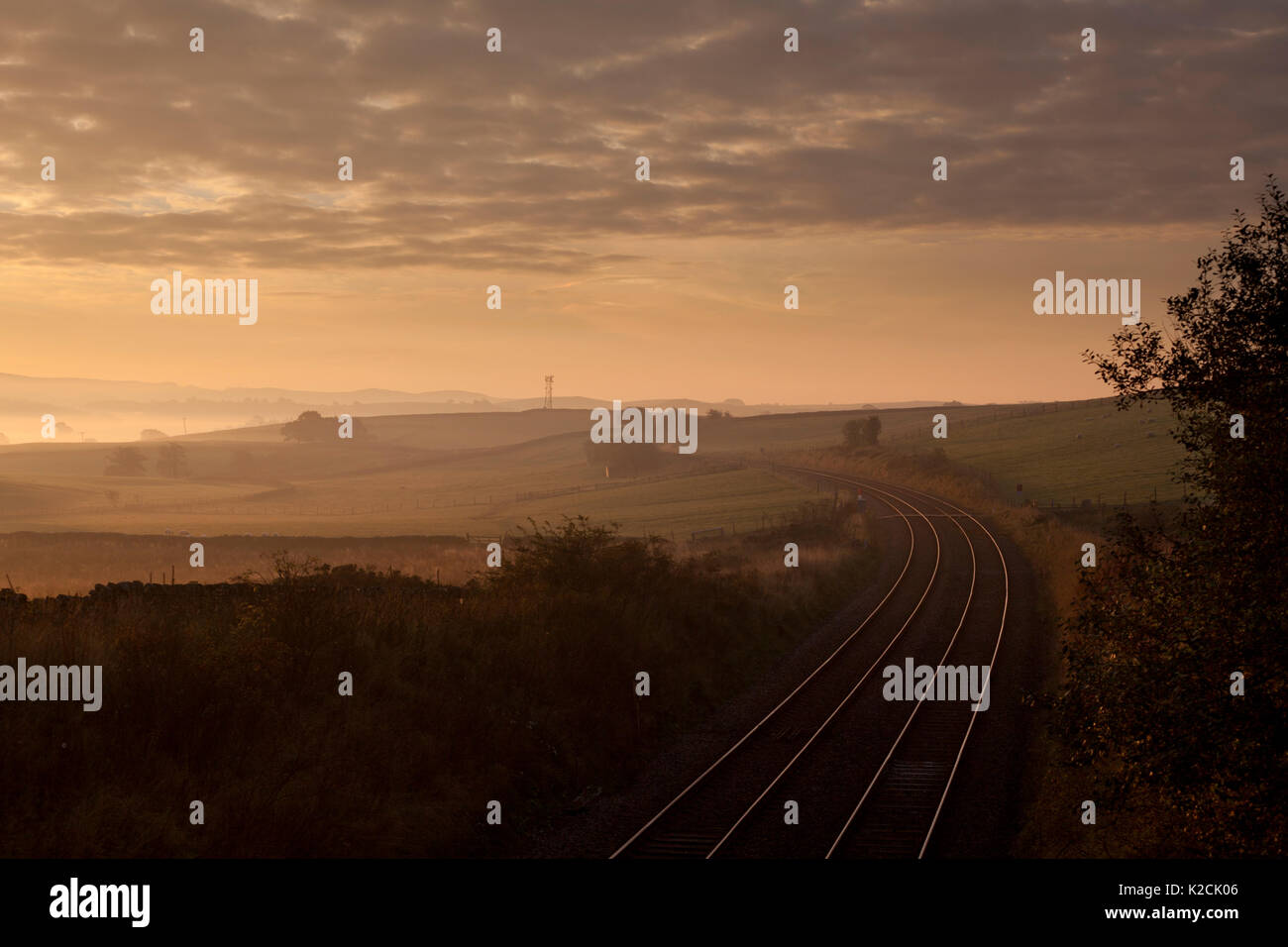 Sunrise over the Network Rail  railway line at Clapham in Yorkshire. - Stock Image