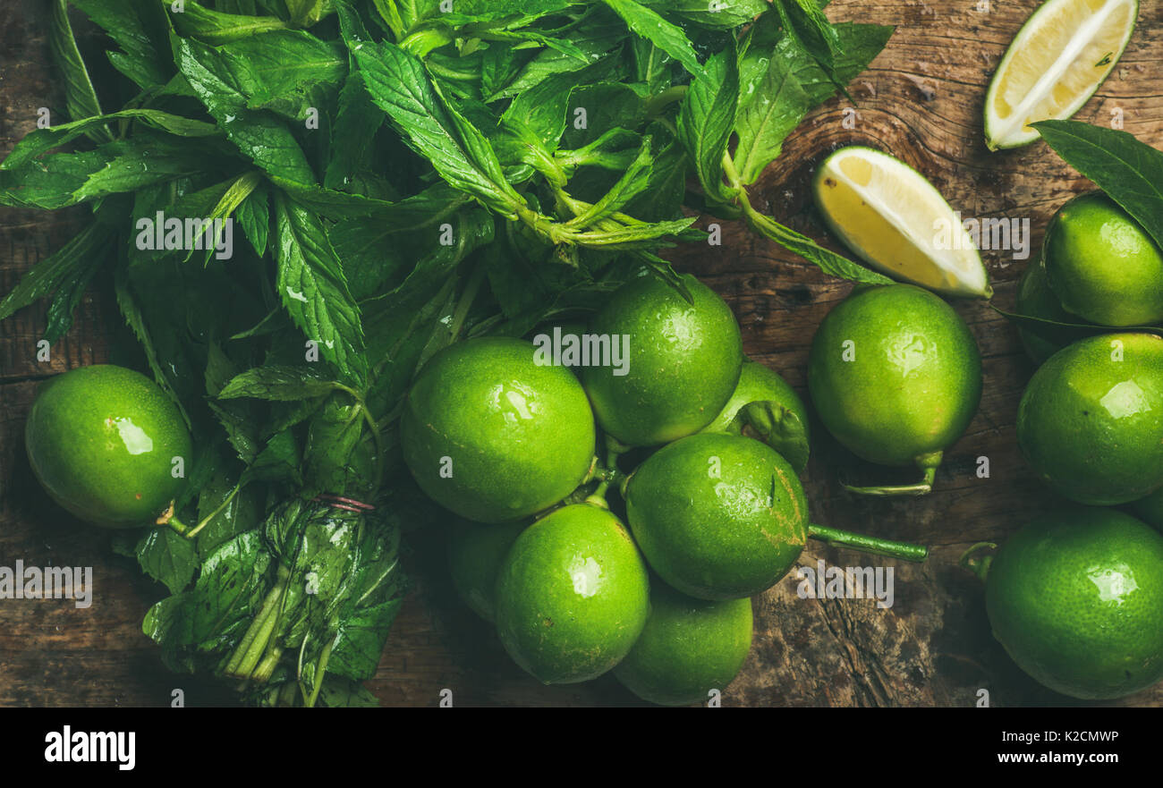 Flatlay of fresh limes and mint for making summer drinks Stock Photo