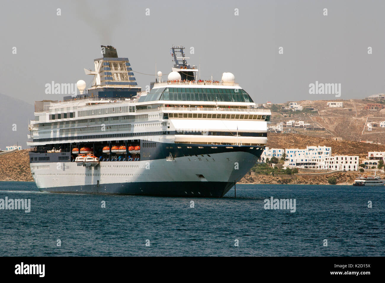 Cruise ship from 'Celebrity Cruises' anchored outside Mykonos Town since it is unable to enter the harbor due to its size. Mykonos Island, Cyclades, Aegean Sea, Mediterranean, Greece, August 2007. - Stock Image