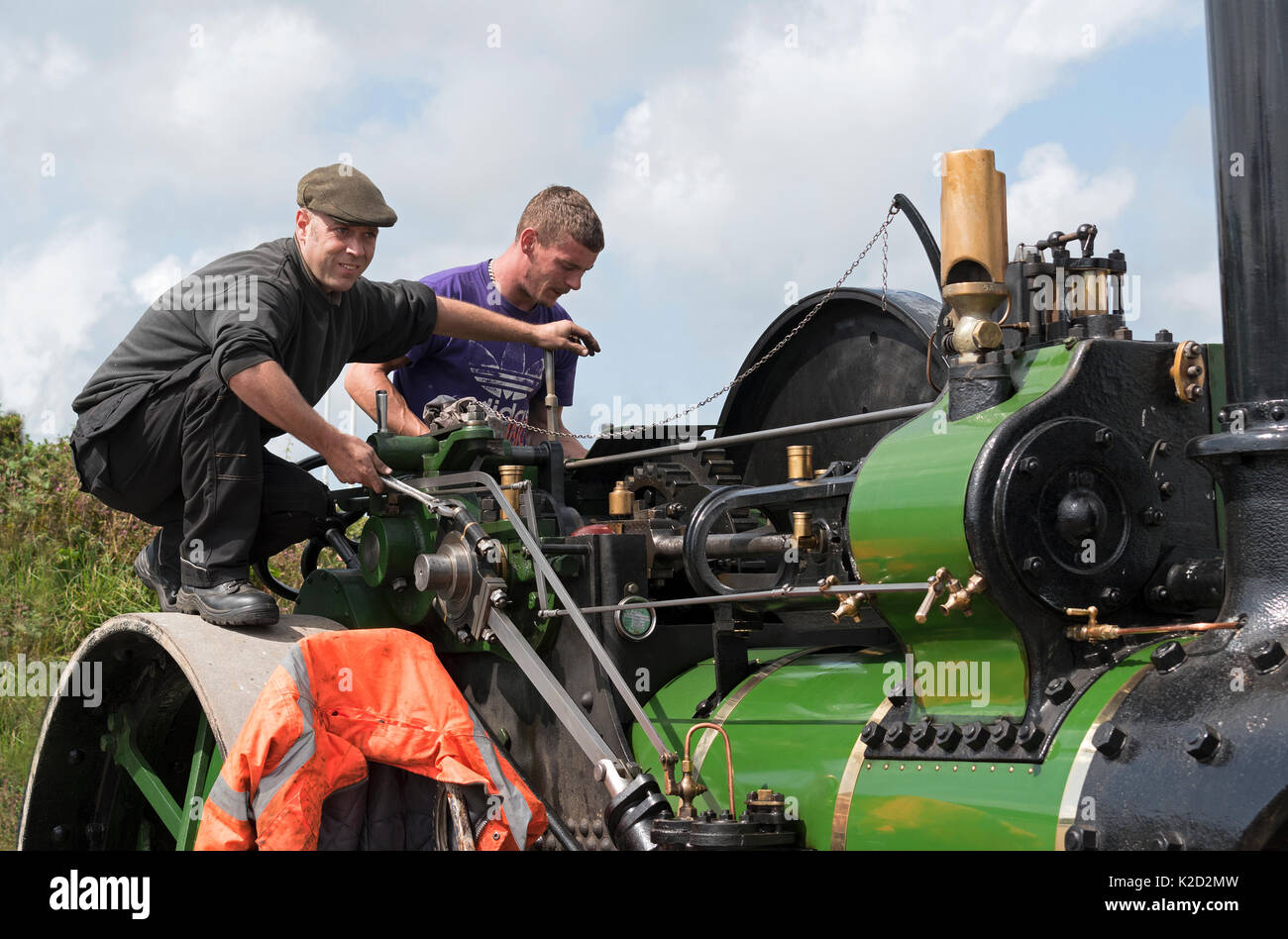 engineers working on a steam engine at vintage rally - Stock Image