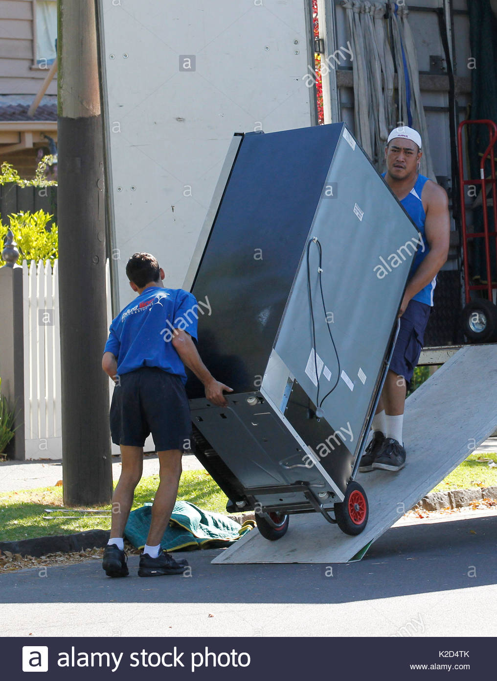 Removalists Unload Household Items And Plants And Garden Ornaments From A  Removal Truck, Into Simone Callahanu0027s New House In Melbourne, Australia.