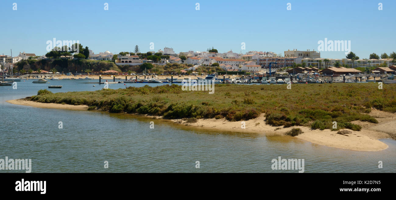 Saltmarsh and estuarine harbour at high tide with moored sailing yachts, Alvor, near Portimao, Algarve, Portugal, July 2013. - Stock Image