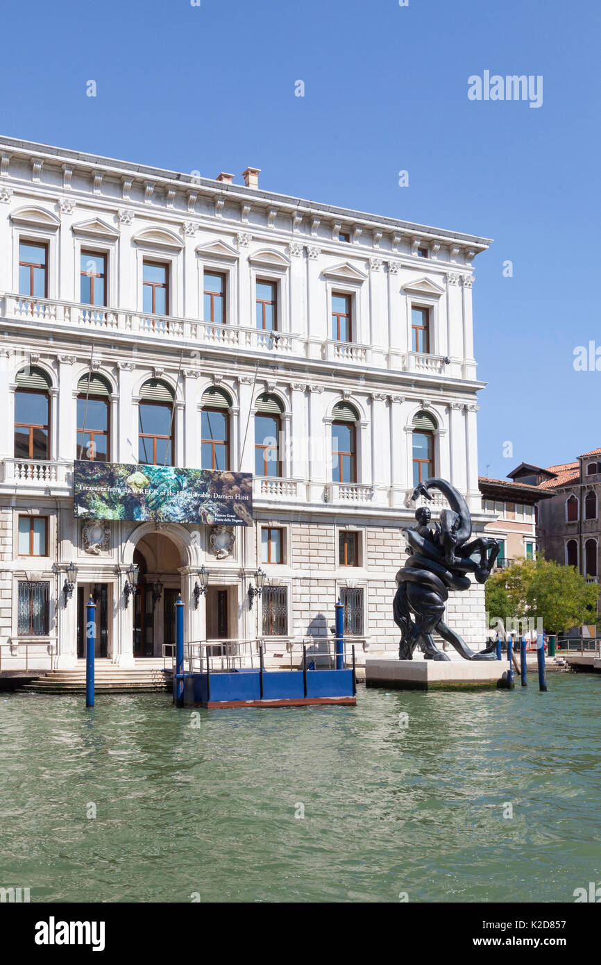 Palazzo Grassi with the banner from the British artist Damien Hirst exhibition Treasures From The Wreck Of The Unbelievable on the Grand Canal, Venice - Stock Image
