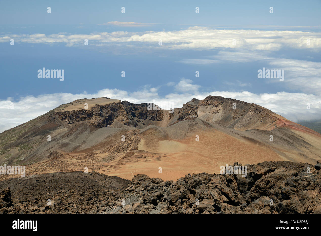 Old lava flows and summit of Pico Viejo Volcano viewed from Mount Teide, with masses of pumice deposits around the crater, Tenerife, May 2014. - Stock Image