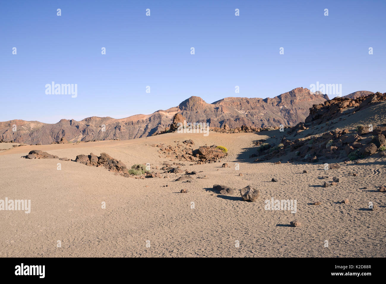 Extensive field of pumice stone surrounded by old volcanos, Las Canadas caldera, Teide National Park, Tenerife, May 2014. - Stock Image