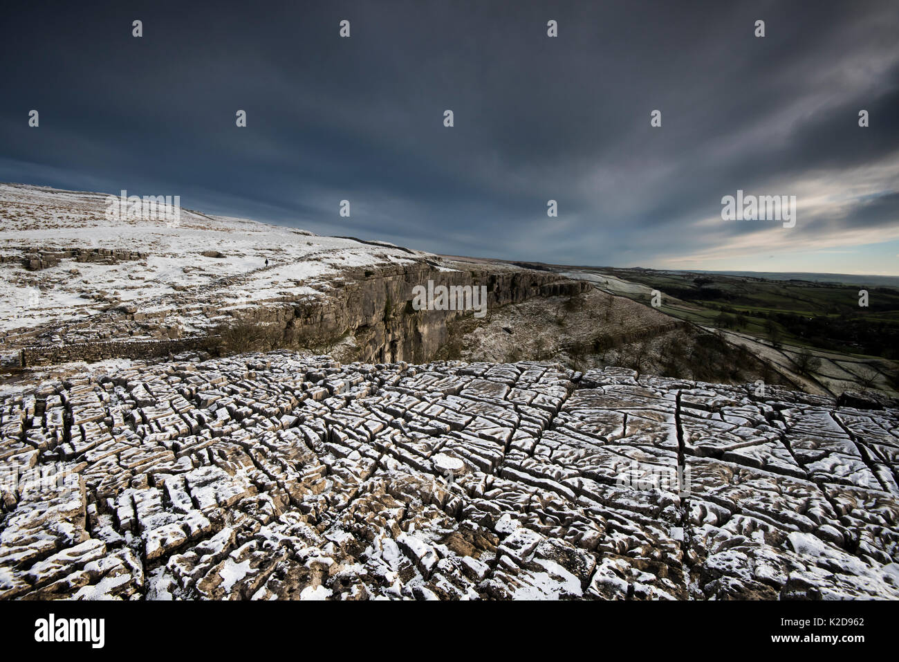 Carboniferous Limestone pavement above Malham Cove, with light dusting of snow, Yorkshire, UK.  January 2014 Stock Photo