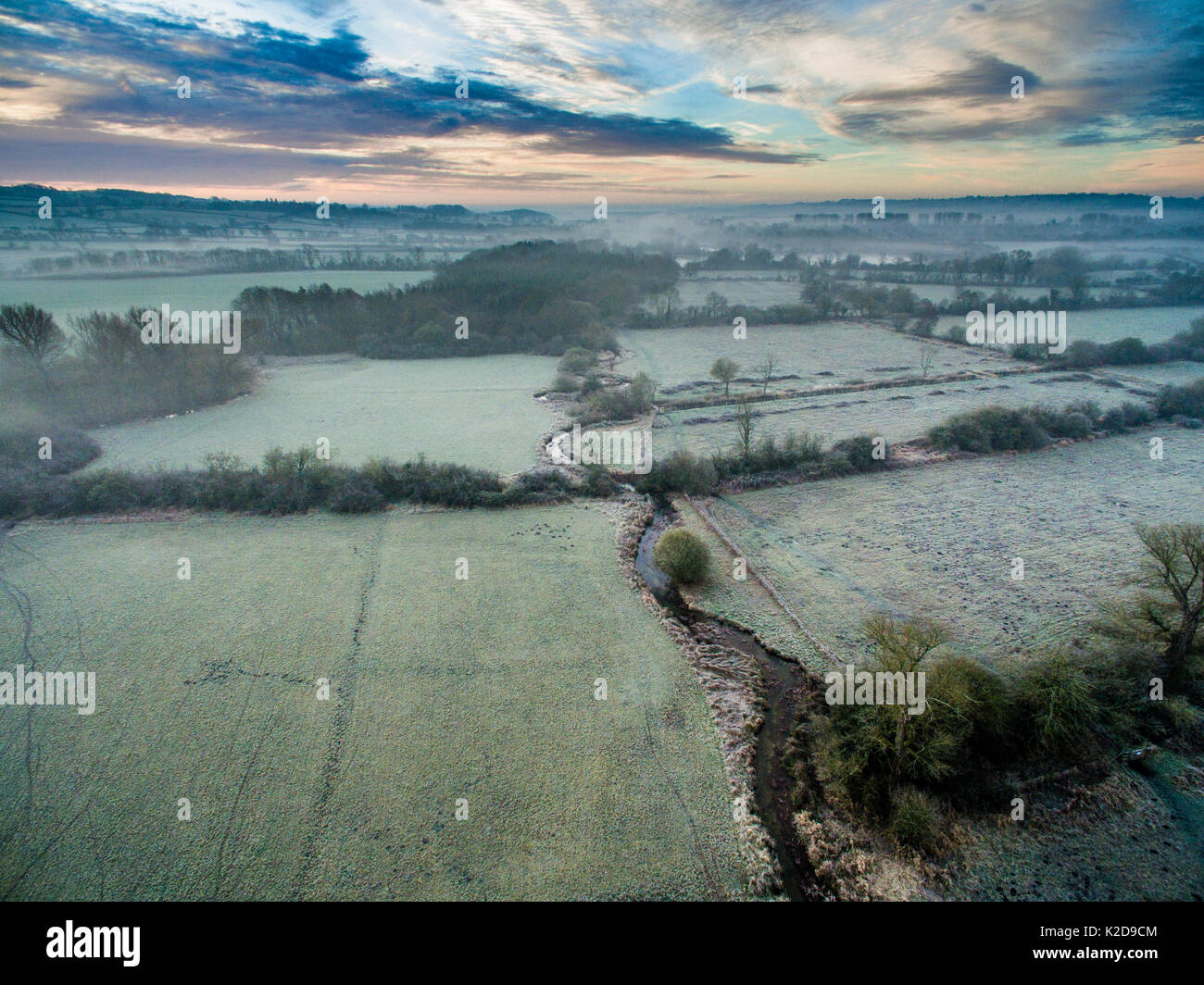 River Eye flowing through water meadows on Greystones Farm Nature Reserve, Site of Special Scientific Interest (SSSI). Gloucestershire Wildlife Trust, Bourton-on-the-Water, Gloucestershire, UK. Shot by aerial drone with CAA permit. November 2015. - Stock Image
