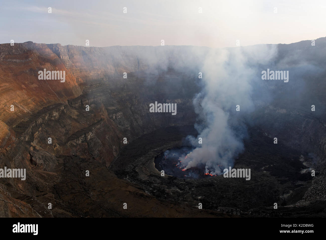 Steam rising from active lava lake in the crater of Nyiragongo Volcano, Virunga National Park, North Kivu Province, Democratic Republic of Congo, Africa - Stock Image