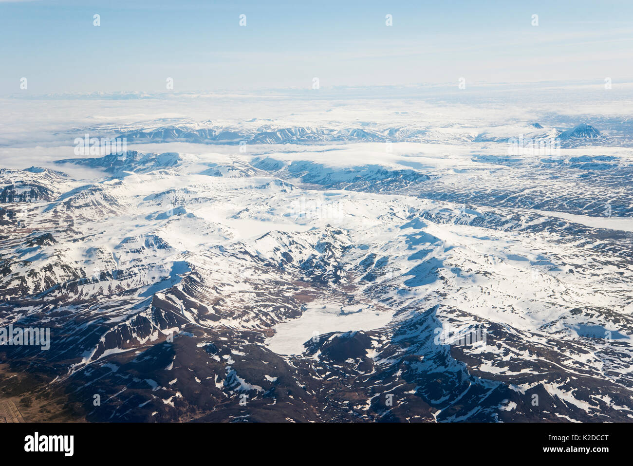 Aerial view of Mountains showing through cloud cover, Westfjords, Iceland. April - Stock Image