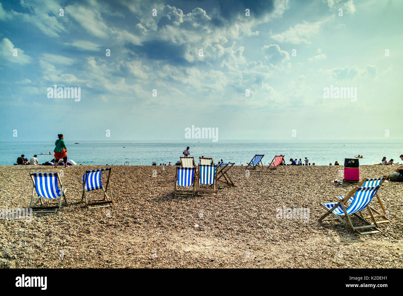 People relaxing on Brighton Beach, Brighton, Sussex, UK, Summer 2017 - Stock Image
