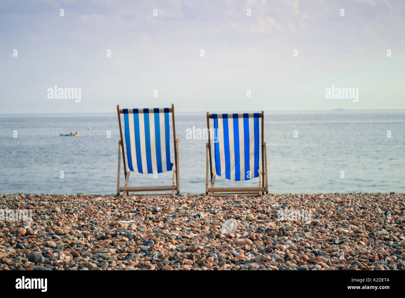 Deckchairs on Brighton Beach, Brighton, Sussex, UK, 2017 - Stock Image