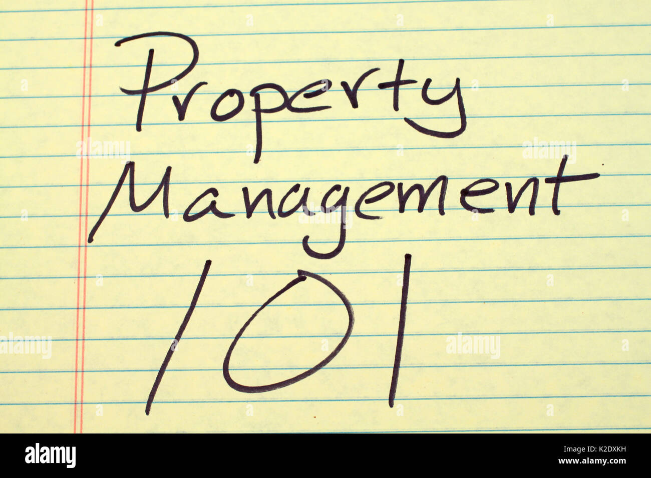 The words 'Property Management 101' on a yellow legal pad - Stock Image