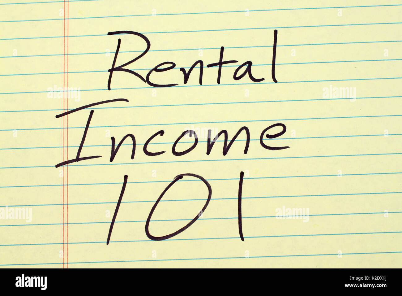 The words 'Rental Income 101' on a yellow legal pad - Stock Image