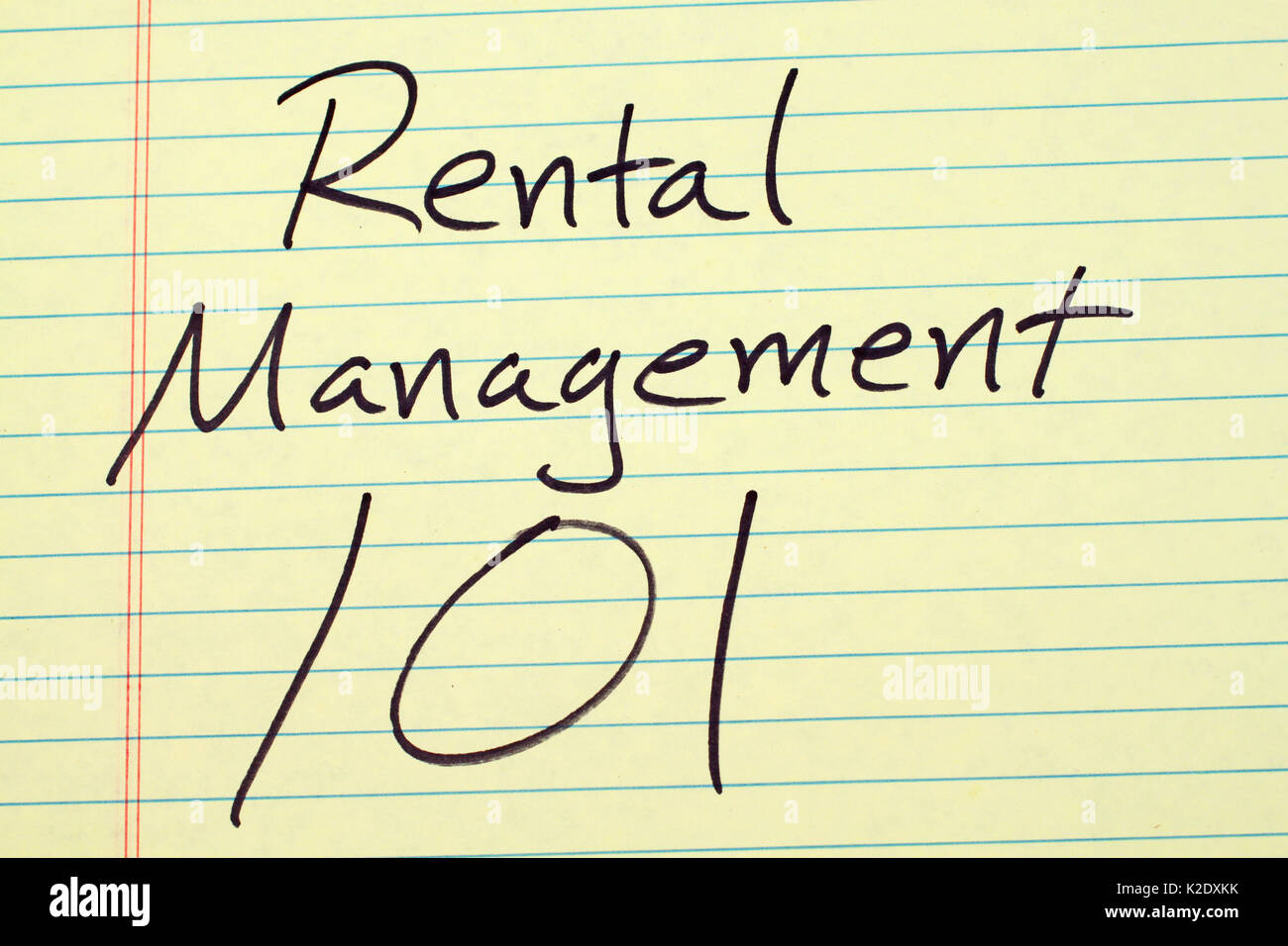 The words 'Rental Management 101' on a yellow legal pad - Stock Image