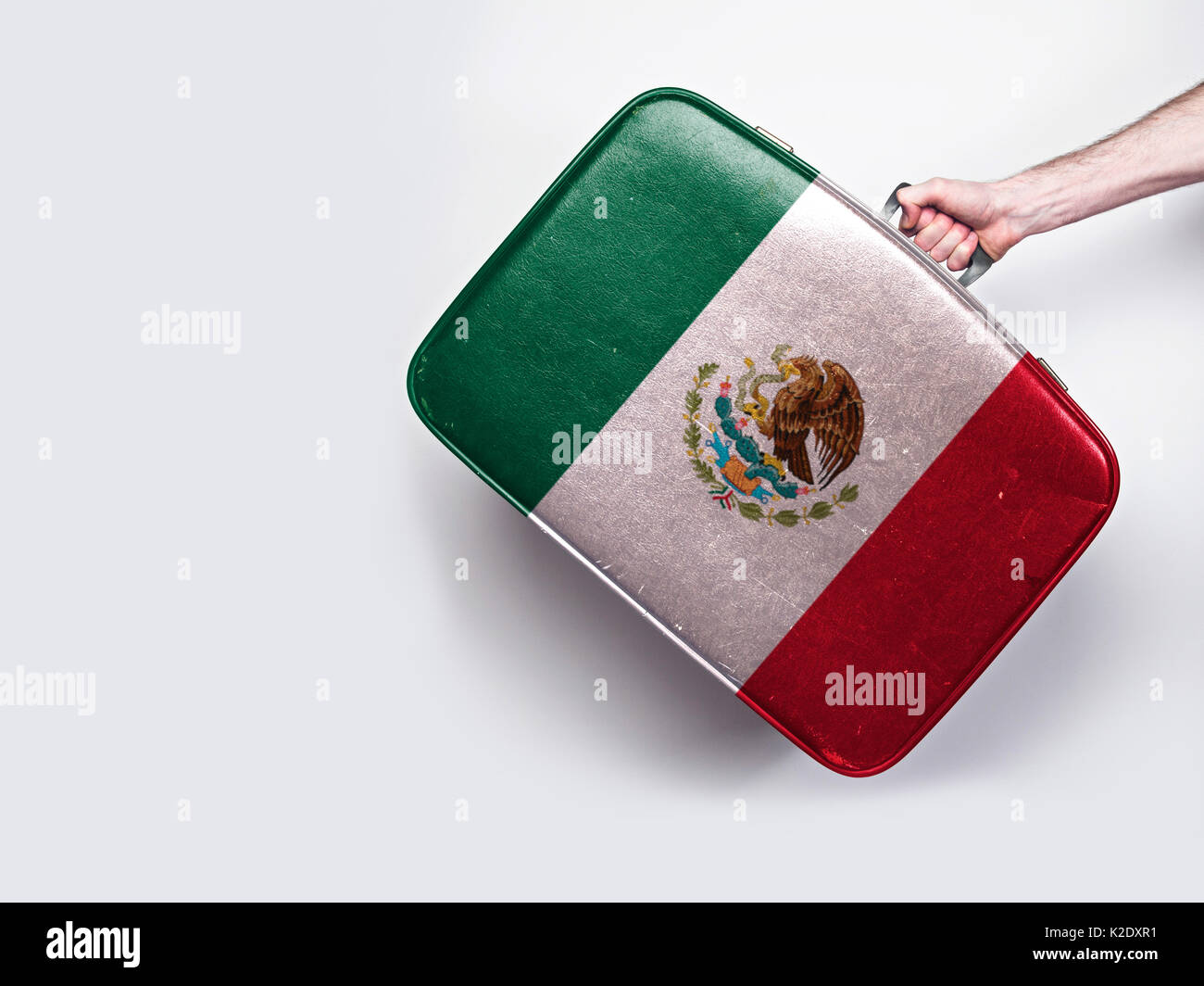 Mexico flag on a vintage leather suitcase. - Stock Image
