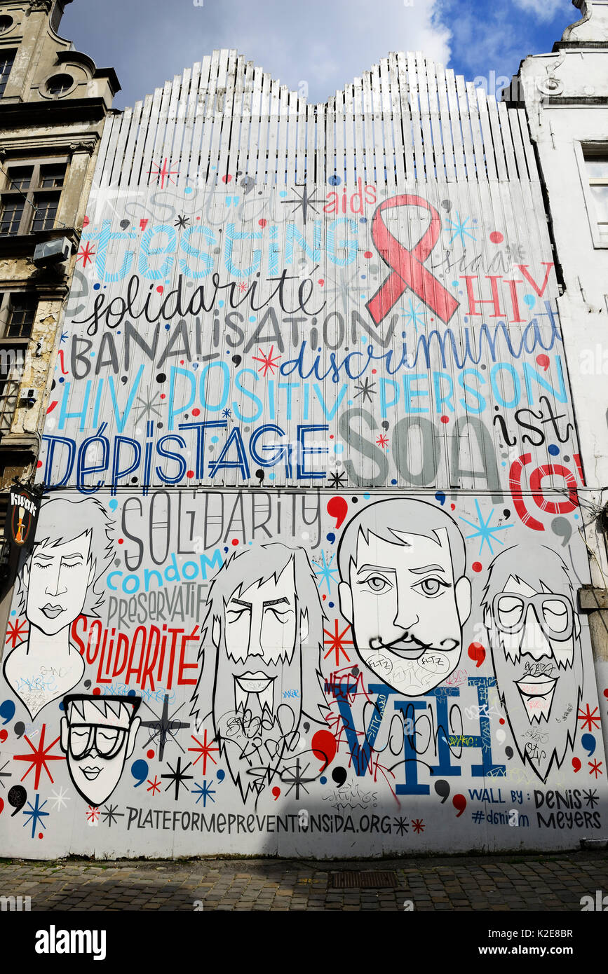 Graffito, House painting for AIDS prevention, Marché aux Herbes, Grasmarkt, Brussels, Belgium - Stock Image
