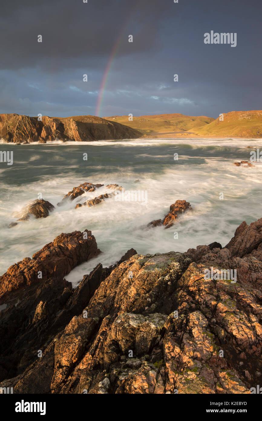 Stormy evening light with rainbow over Mangurstadh / Mangersta beach, Isle of Lewis, Outer Hebrides, Scotland, UK, October 2014. - Stock Image