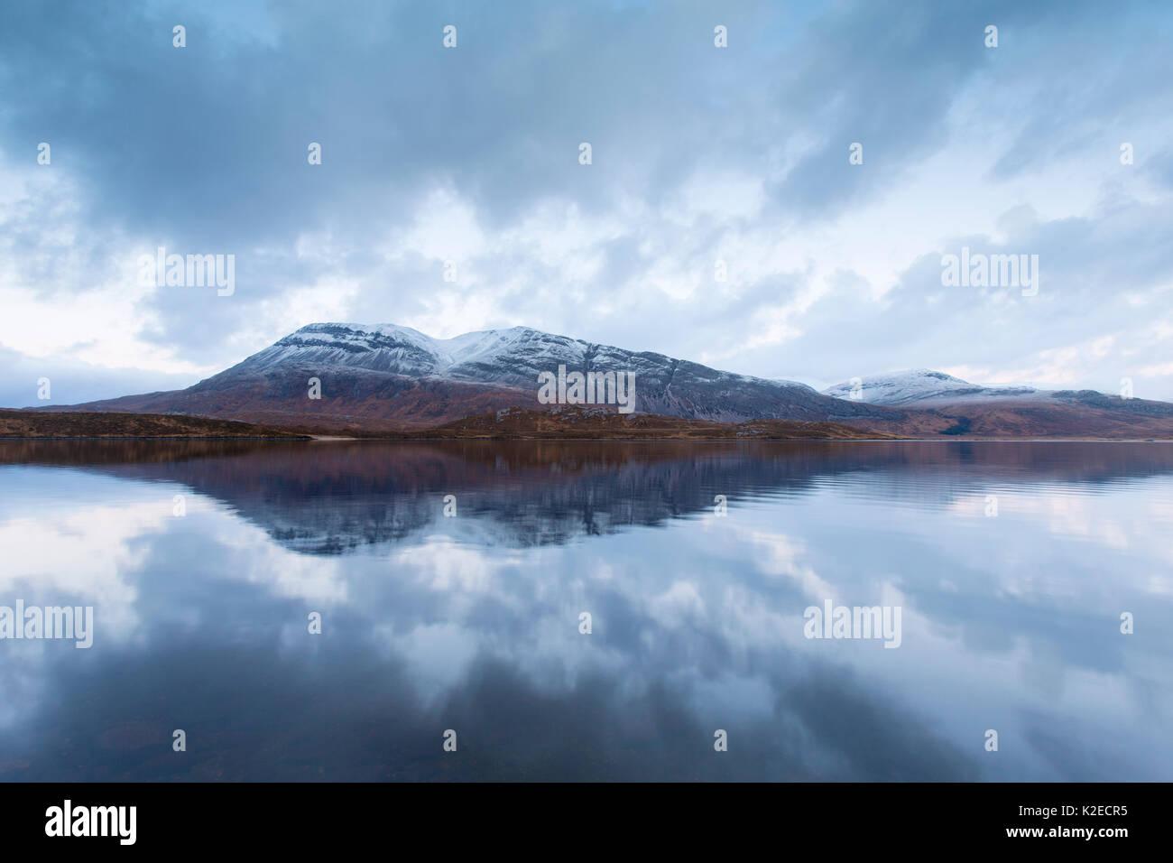 Arkle reflected in Loch Slack at dusk, Sutherland, Highlands, Scotland, December 2014. - Stock Image