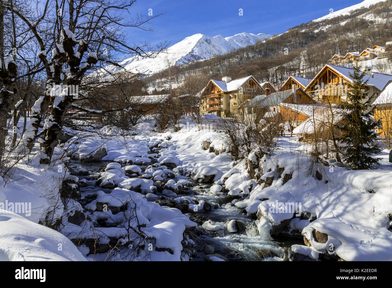 La Valoirette mountain river in winter in front of Valloire ski resort, Savoie in the French Alps. Maurienne Valley, France - Stock Image