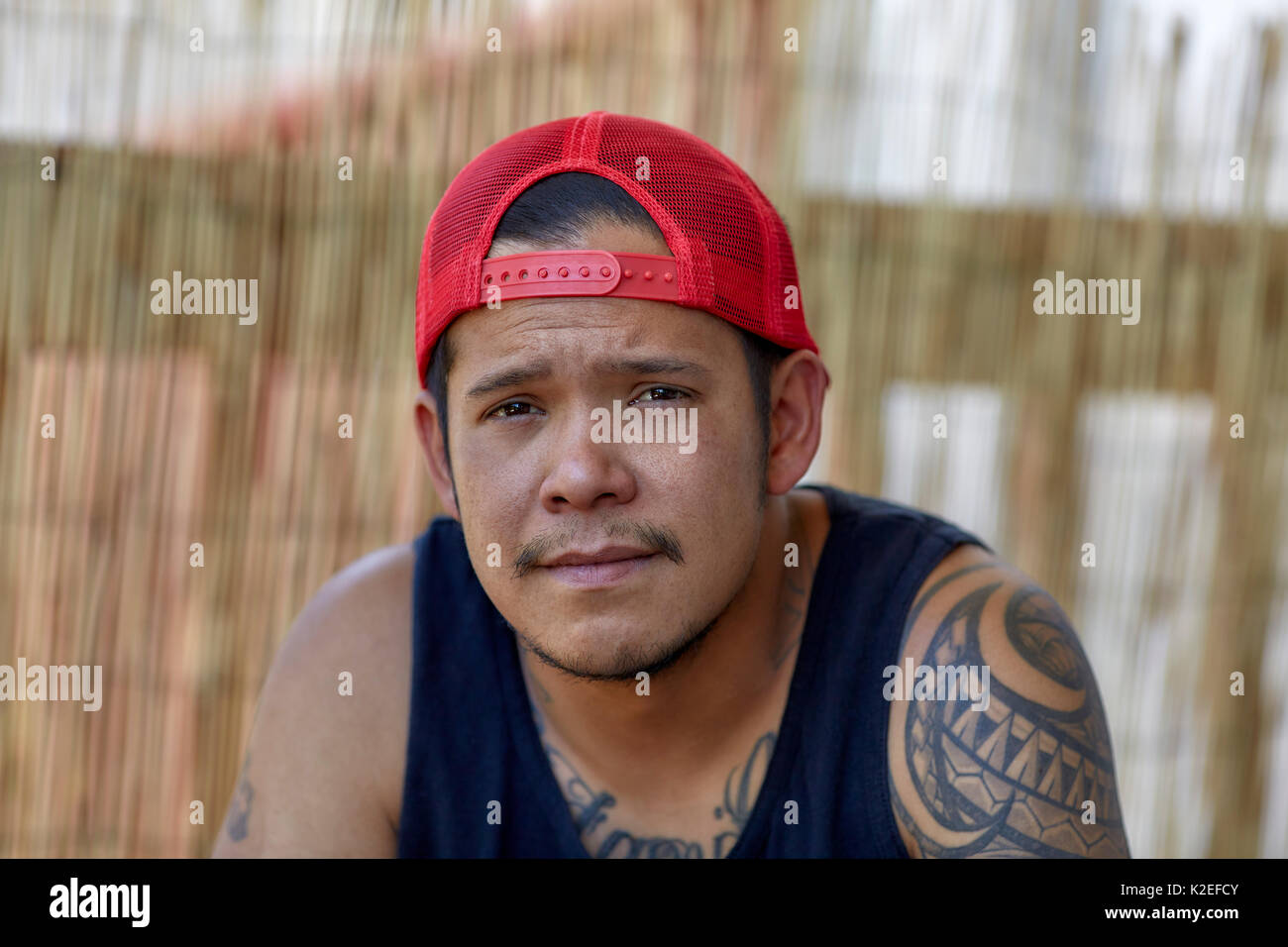 Young Adult Man Wearing A Baseball Cap Backwards With Tattoos On His Stock Photo Alamy