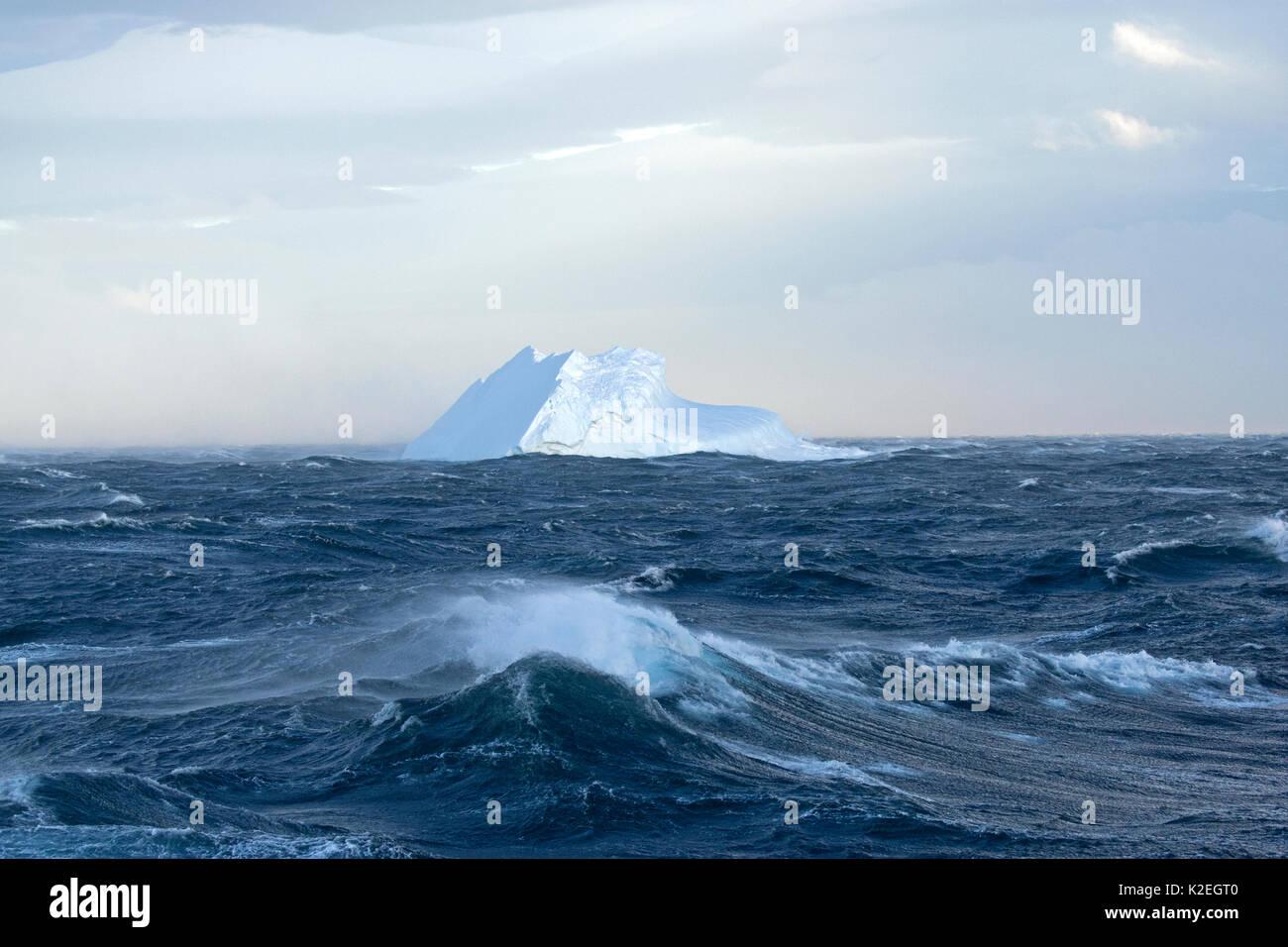 Iceberg in rough seas, Bransfield Strait, Antarctic Peninsula, Antarctica. December 2015. Stock Photo