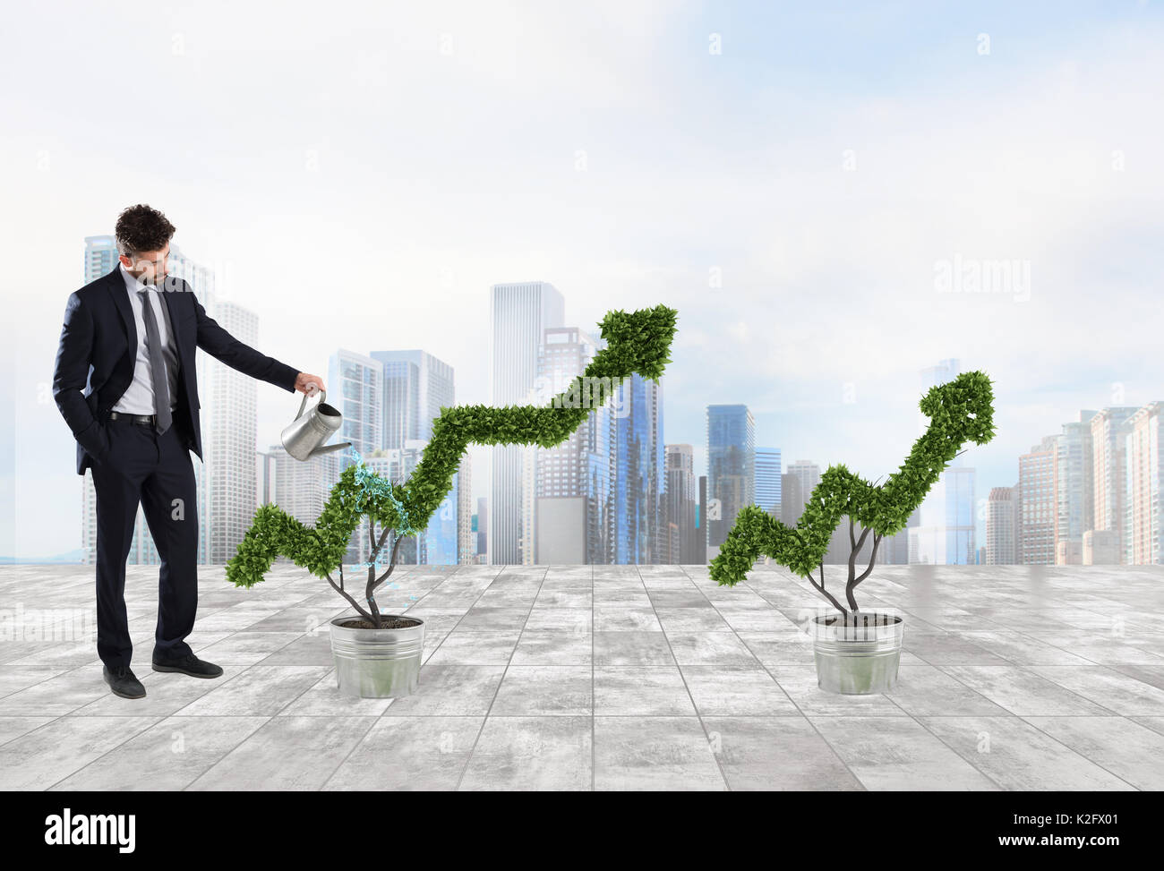 Businessman that watering a plant with a shape of arrow. Concept of growing of company economy . - Stock Image