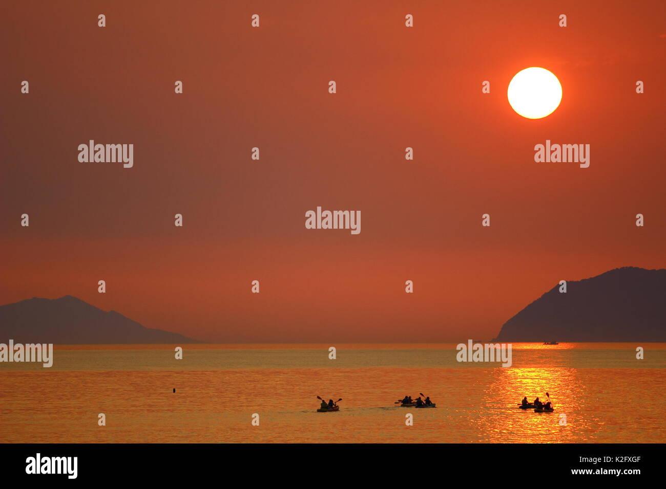 Sea kayaking at sunset, warm summer day, Croatia - Stock Image