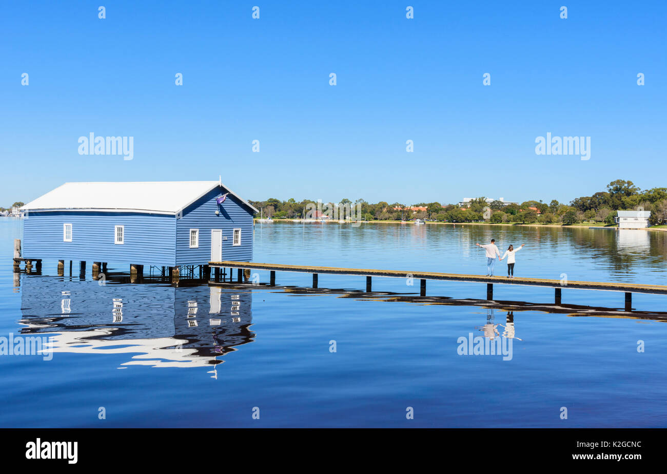 Tourists on the boardwalk of the Crawley Edge Boatshed or Blue Boat House on the Swan River in Matilda Bay, Crawley, Perth, Western Australia - Stock Image