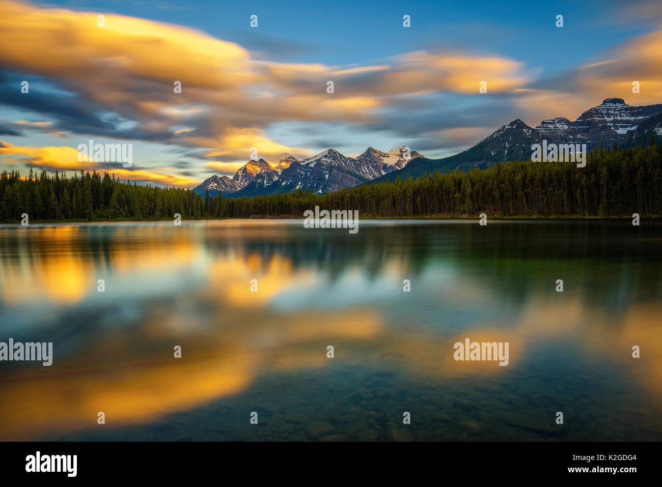 Scenic sunset over Herbert Lake along the roadside of the Icefields Parkway in Banff National Park, Alberta, Canada. Long exposure. - Stock Image