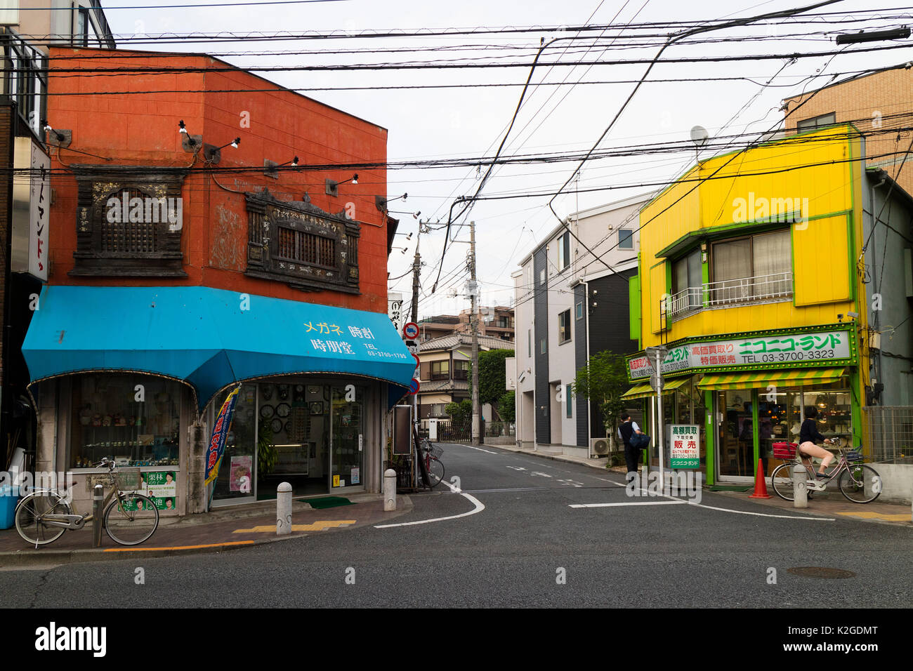 Tokyo, Japan -  May 11, 2017: Colorful shops at a corner of the street in the neighbourhood, - Stock Image