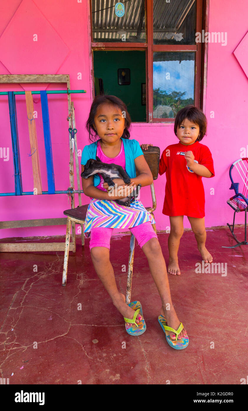 Boruca children outside pink house, indigenous people, Costa Rica. December 2014. - Stock Image