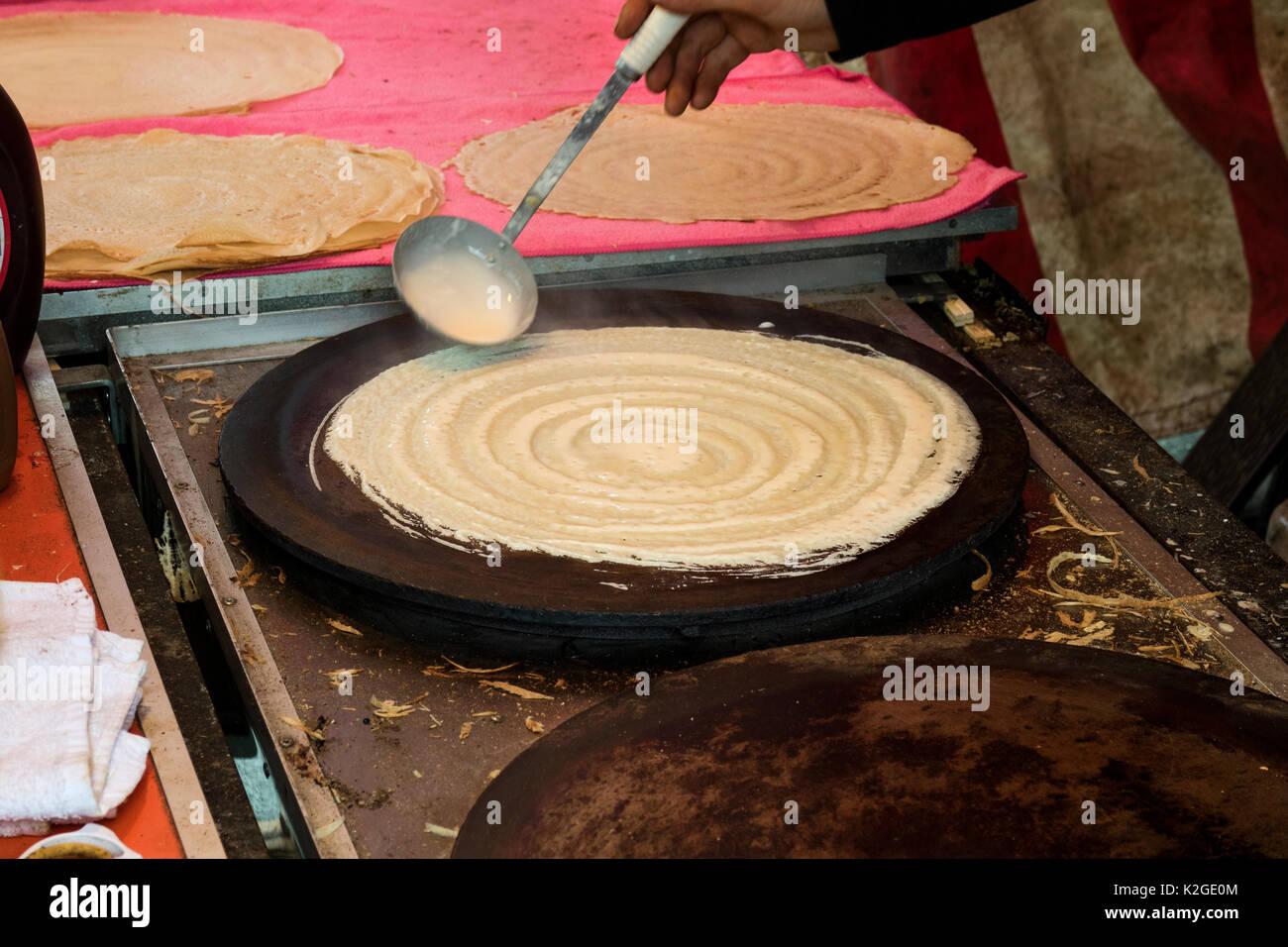 Tokyo, Japan - May 14, 2017: Baking pancakes, Okonomiyaki, at the Kanda Matsuri Festval - Stock Image