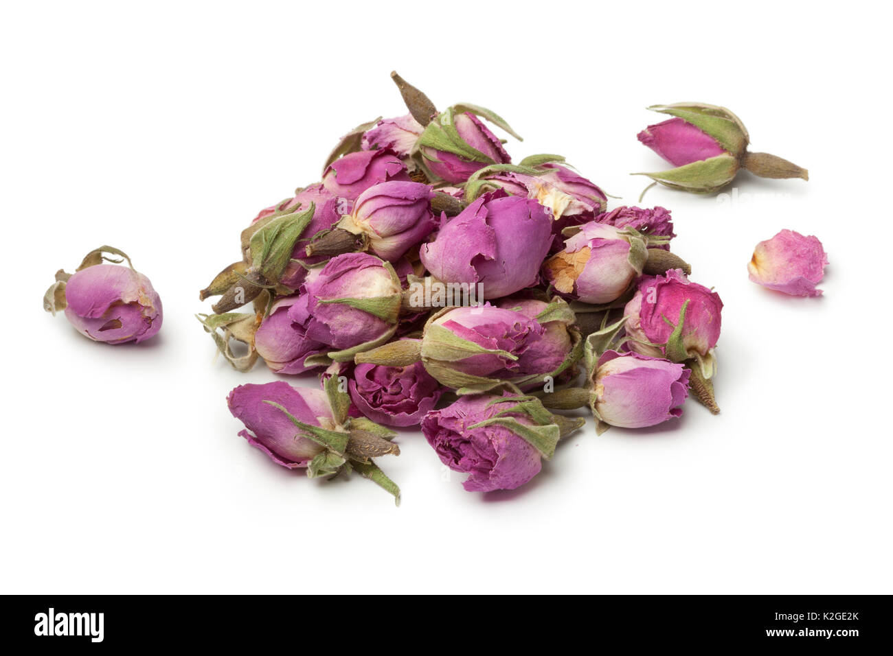 Heap of dried rose buds on white background - Stock Image